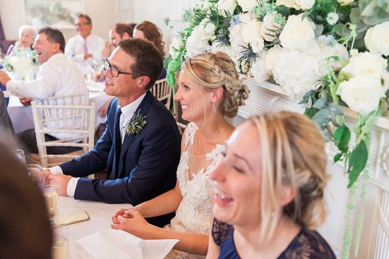 Bride And Groom Reacting To Best Man's Speech
