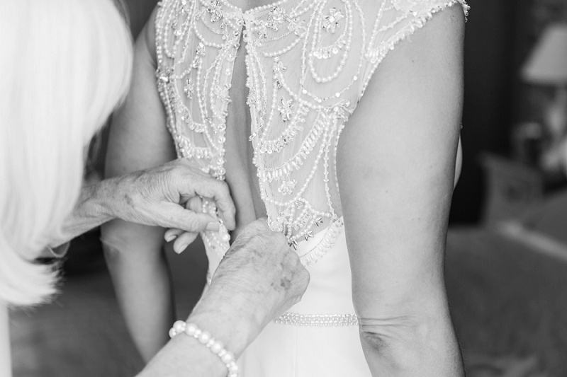 Bride Getting into Her Beaded Maggie Sottero Gown