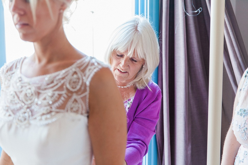 Mother of the Bride Helping the Bride With Her Beaded Maggie Sottero Gown