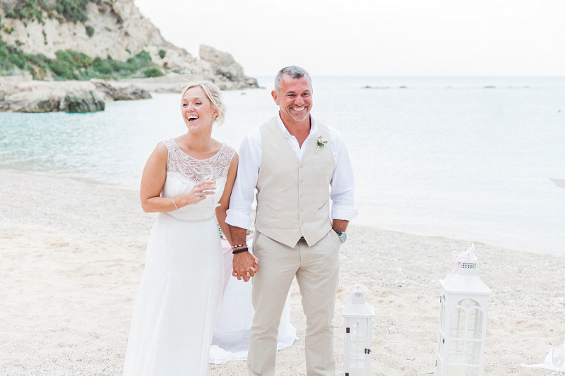 Bride and Groom Laughing During Speeches on Agios Nikitas Beach