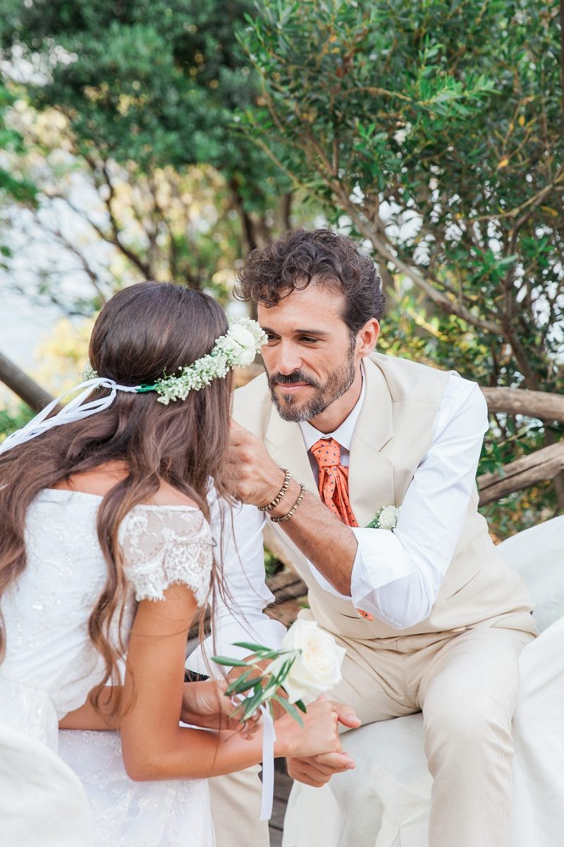 Bride and Groom Sharing an Emotional Moment During the Readings At Their Bohemian Wedding