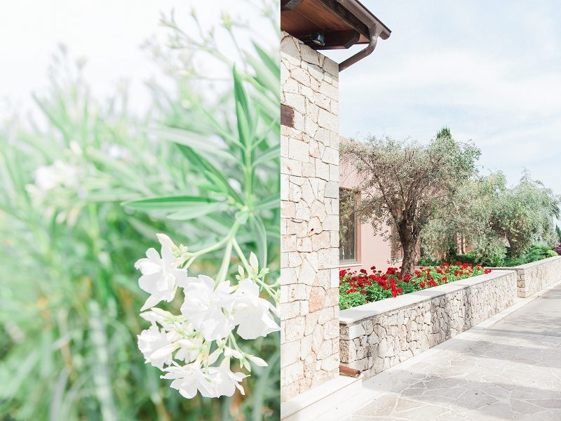 Stone Collumns and White Flowers at the Entrance of Ionian Blue Hotel