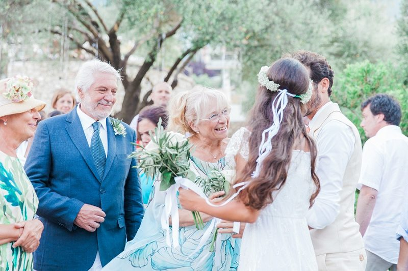 Couple Giving Grooms Mom Flowers After Their Ceremony