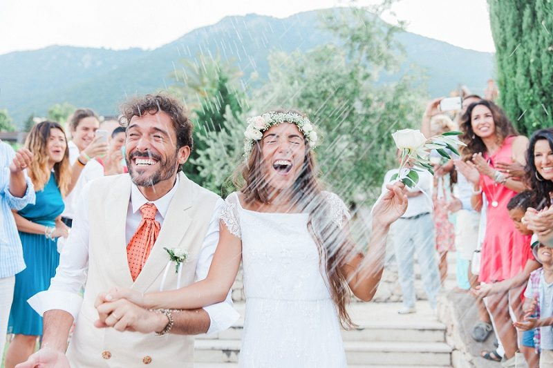 Couple Being Showered in Confetti After there Ceremony