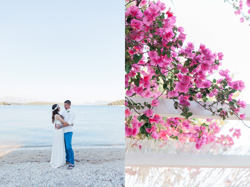 Couple On the Beach with Pink Bougainvillea During their Seaside Elopement