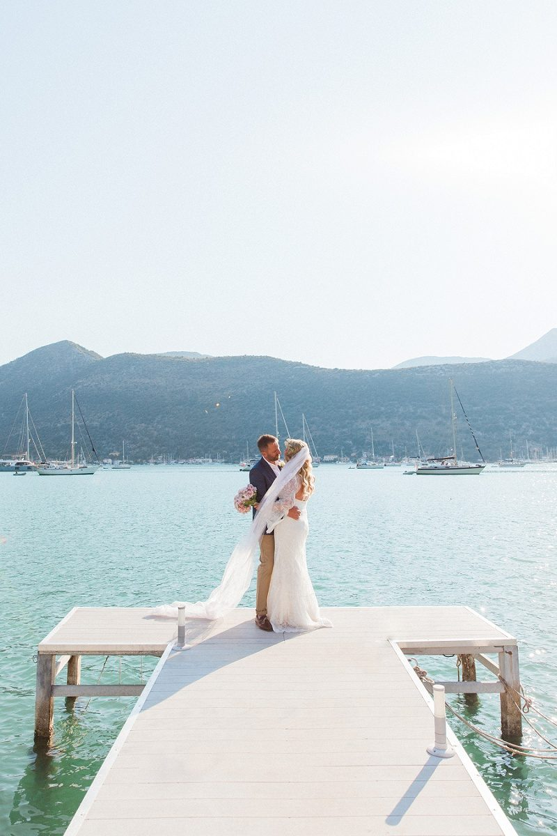 Couple Kissing on the Jetty At SeaSide Restaurant