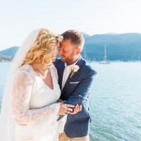 Bride and Groom Against Blue Greek Sea
