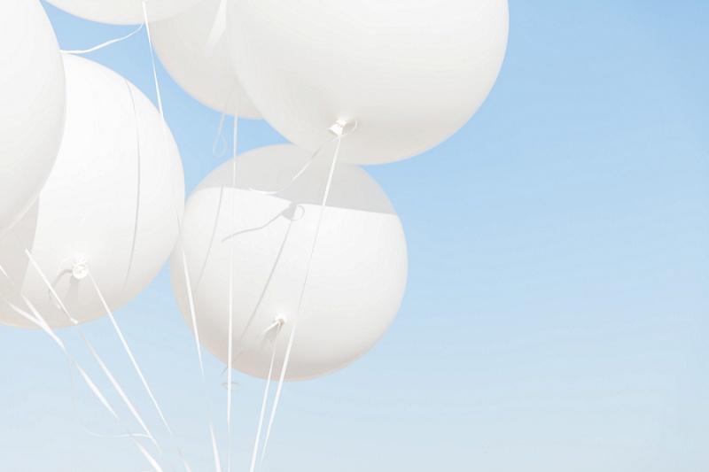 Giant White Balloons Against The Sky In Santorini