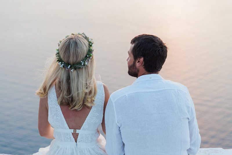 Bride and Groom On A Church Rooftop After Their Sunset Elopement In Santorini