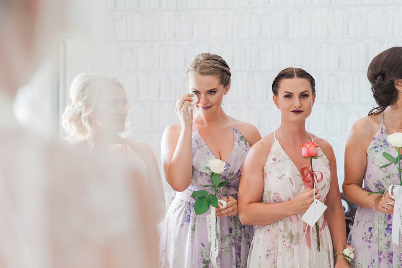 Bridesmaid in her Dessy dress tearing up as the bride sees her father