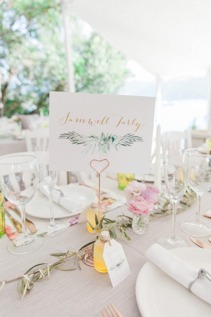 Table name with rose gold heart shaped holder on the wedding tables at Seaside Restaurant