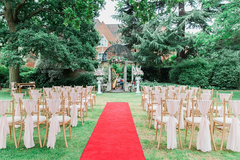 Ceremony Gazebo with Red Carpet and chairs set up for Gracia and Ravi's Wedding at Warren House
