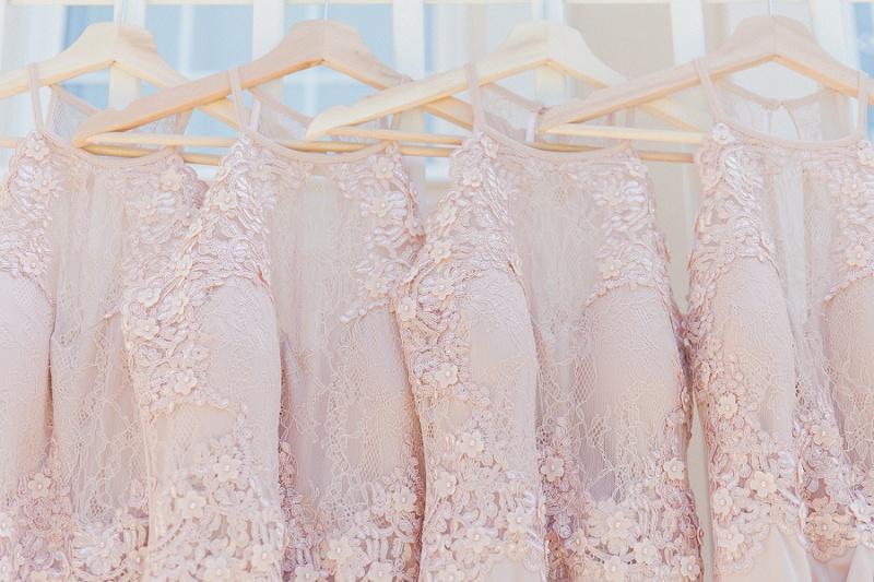 Soft pink bridesmaids dresses hanging in a row at Villa Rosa on Kefalonia