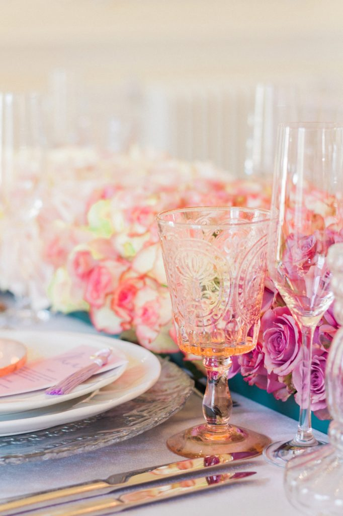 Pink and clear glassware and ombre rose garland at a 10-11 Carlton House Terrace wedding