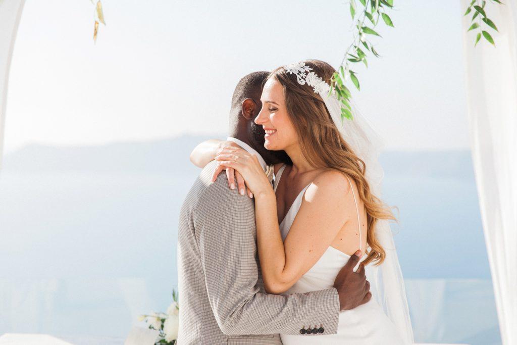 Couple hug after their elopement at Dana Villas Santorini