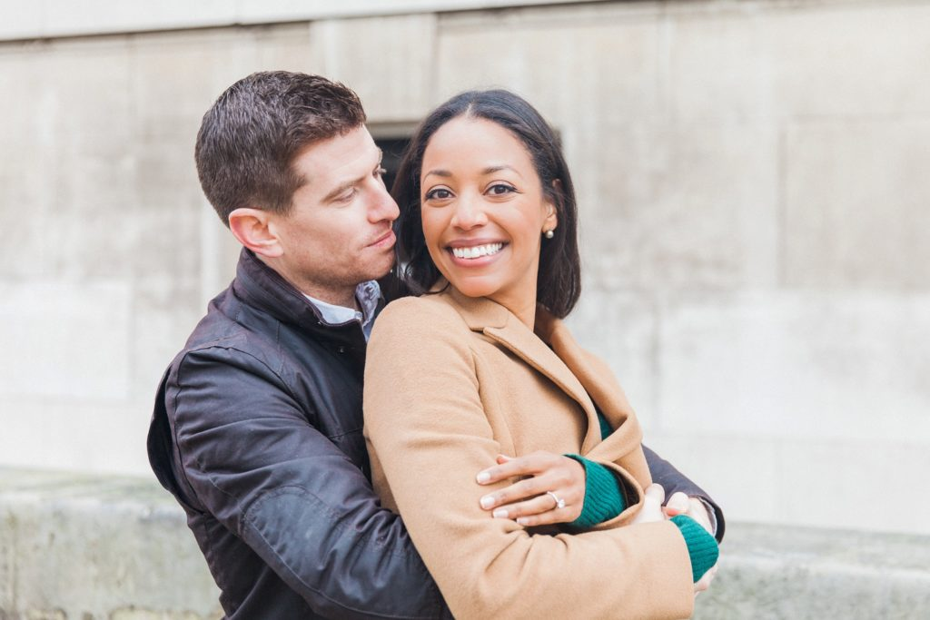Couple hug during their London engagement session