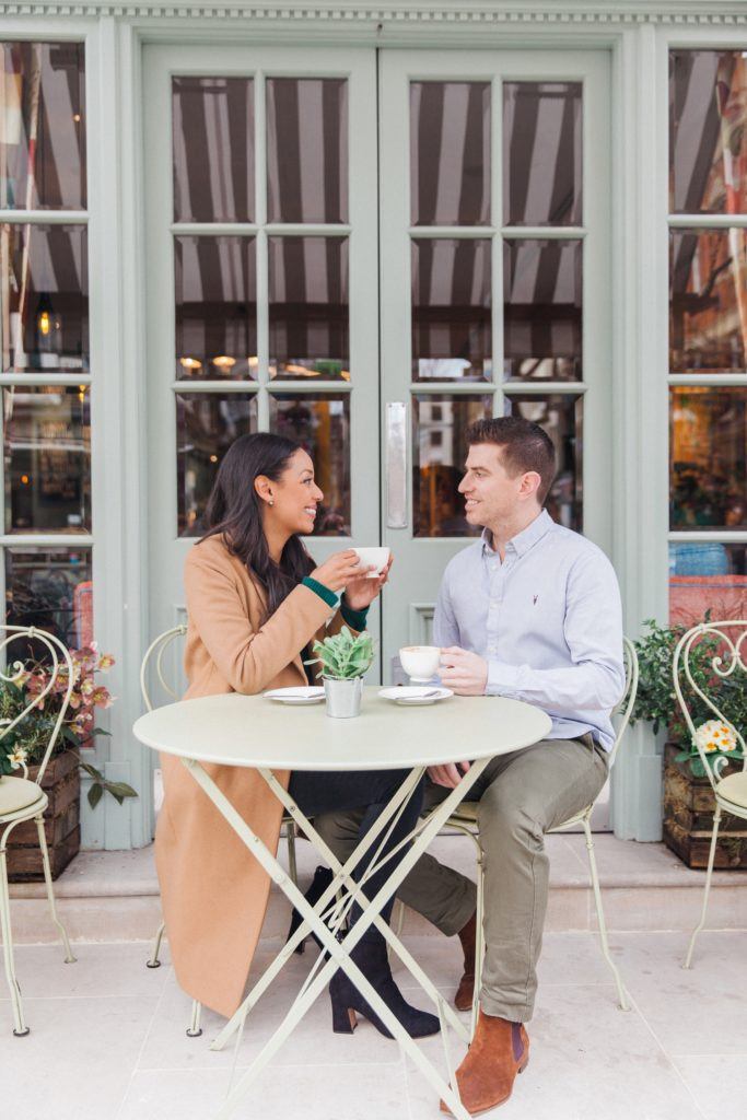 Couple enjoy a cappuccino during their Charlotte Street Hotel engagement session
