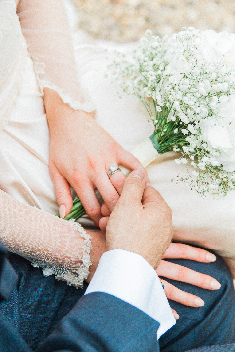 Couple holding hands showing the brides diamond ring