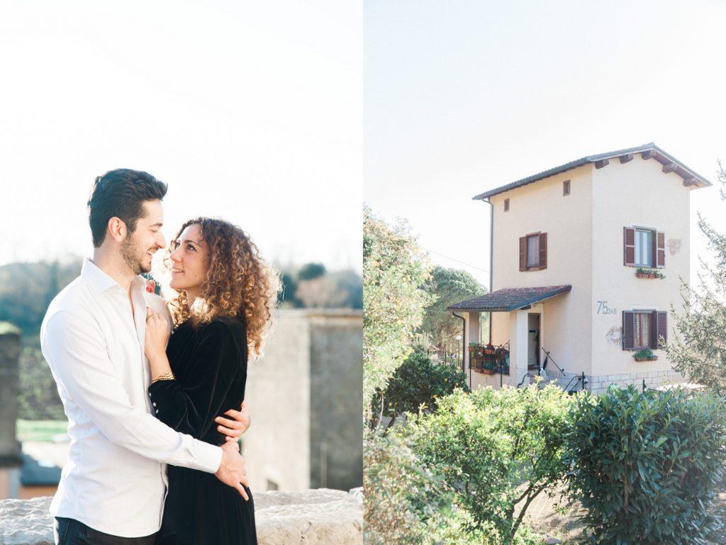 Couple next to a refurbished railway house in Sermoneta, Italy