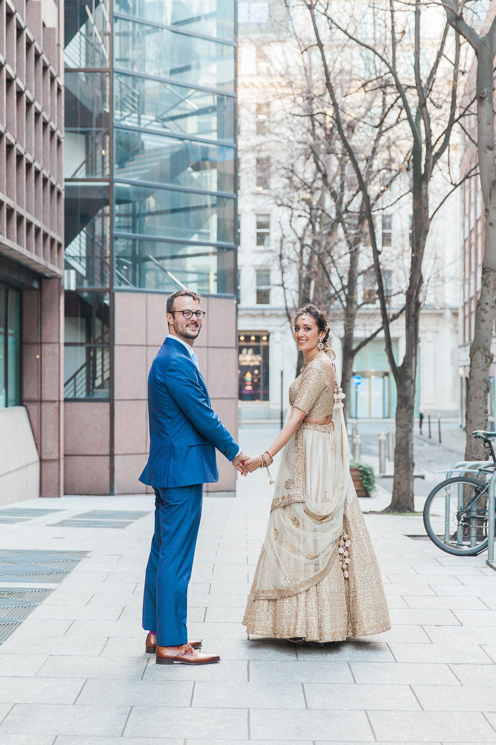 Bride and groom on the streets of London during their multicultural wedding
