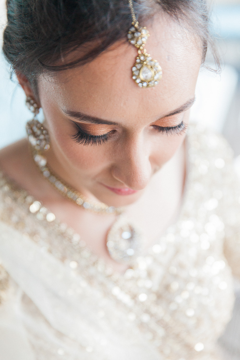 Portrait of an Asian bride with London wearing traditional Indian jewellery