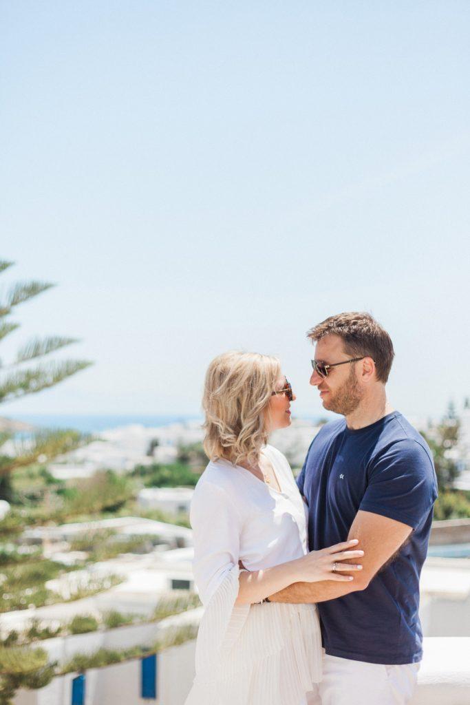 Couple hug with a view towards the sea on Mykonos island