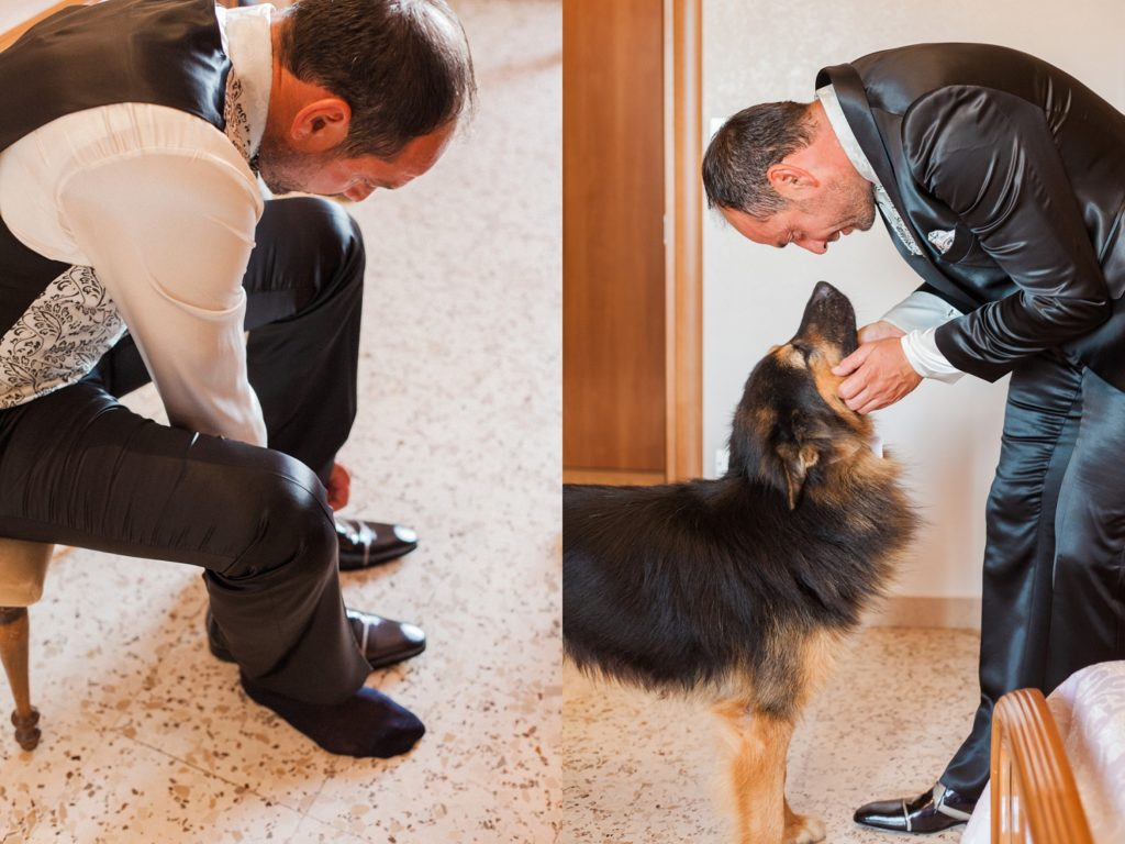The groom puts on his wedding shoes with his dog on the morning of his wedding in Apulia