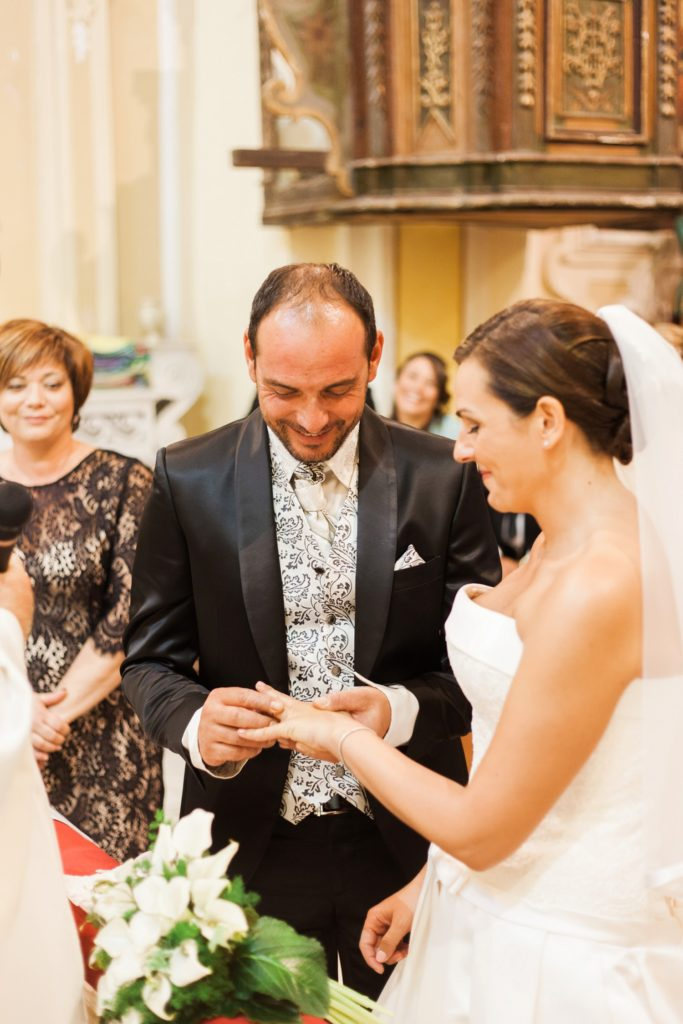 Italian couple exchange rings in a traditional church in Apulia