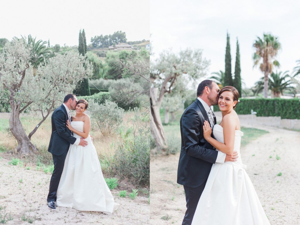 The bride and groom in the gardens of the Convivium Hotel in Vasto during their Abruzzo wedding