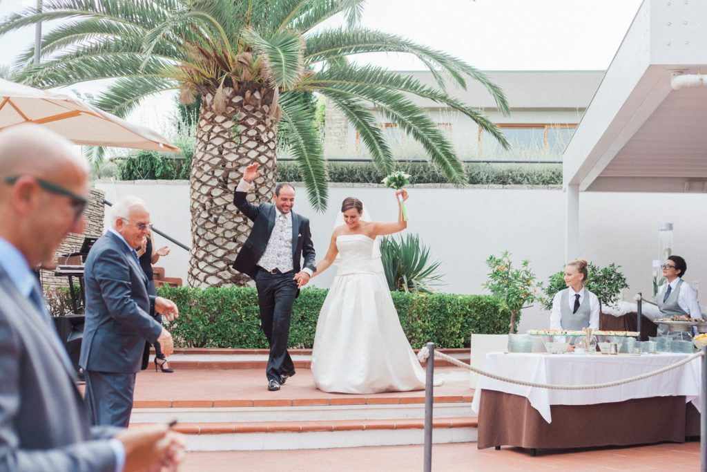 Italian couple make their entrance to their wedding reception at the Convivium Hotel in Abruzzo