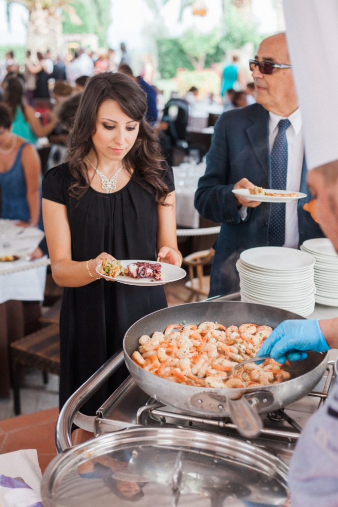 Wedding guests gets served prawns by a chef at the Convivium Hotel