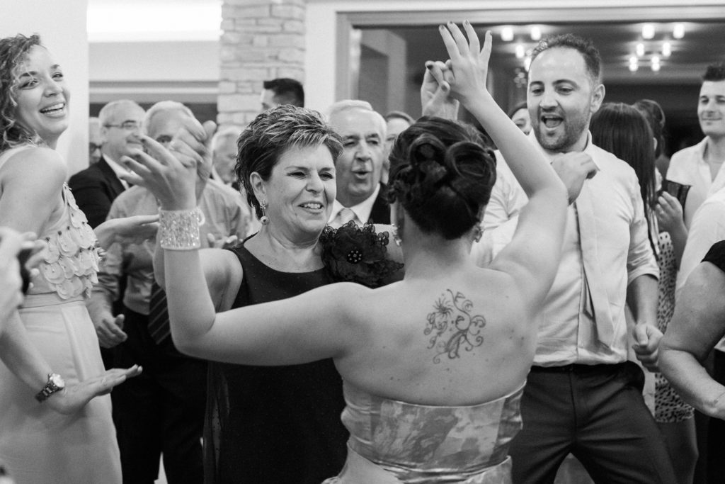 Wedding guests dance at a reception at the Convivium Hotel