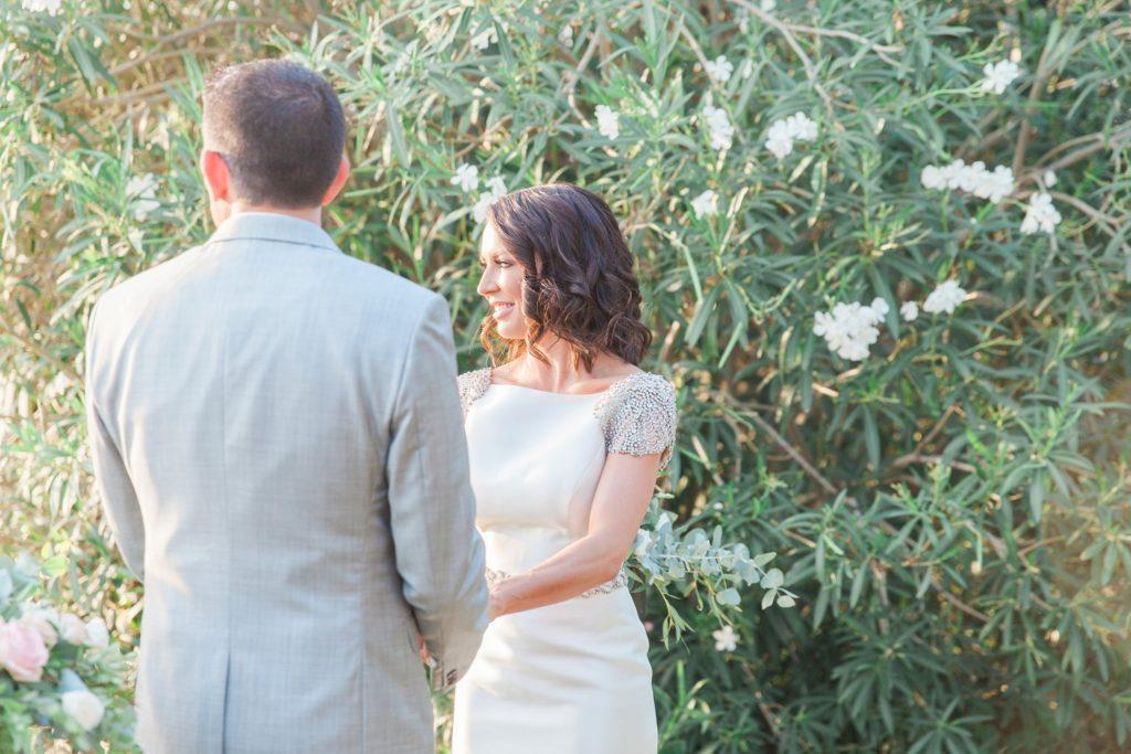 Happy couple during their wedding ceremony at Domotel Agios Nikolaos in Sivota