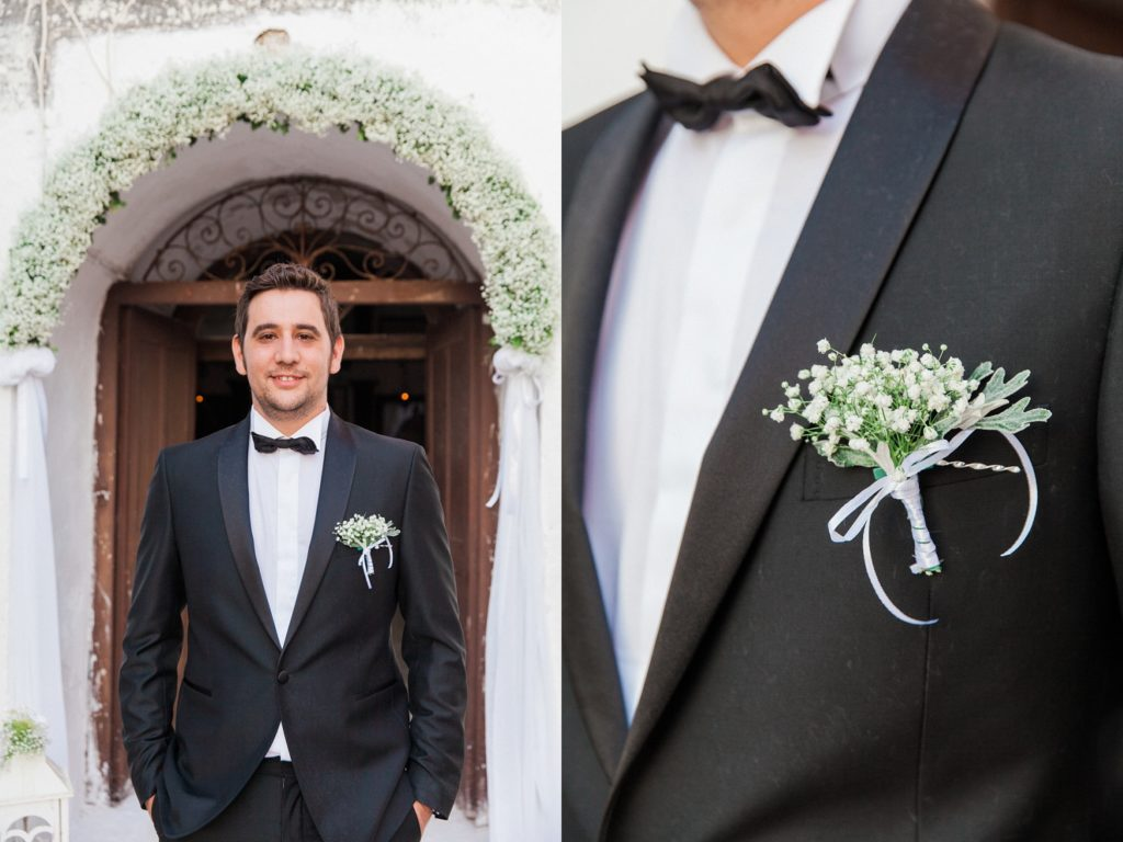 Portrait of a groom and his gypsophila buttonhole outside the church inside Santa Maura Castle in Lefkada