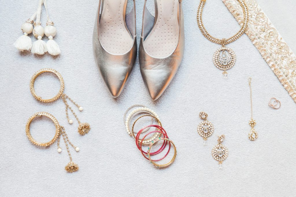Flatlay of an Indian brides wedding shoes and gold jewellery