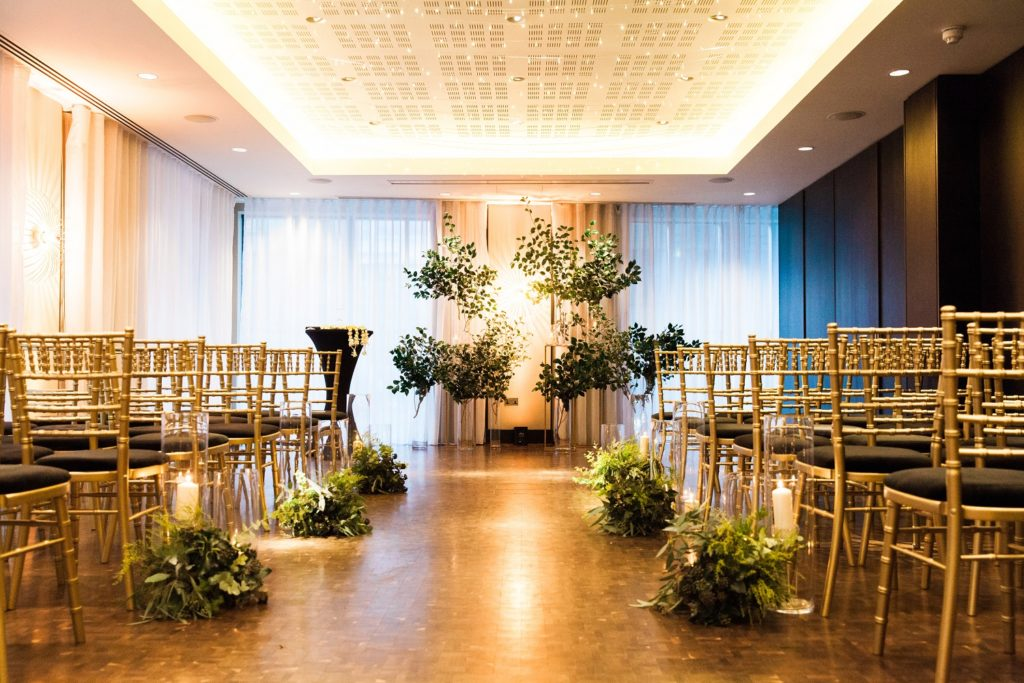Mixed culture ceremony decor with foliage and candles at a South Place Hotel wedding in London