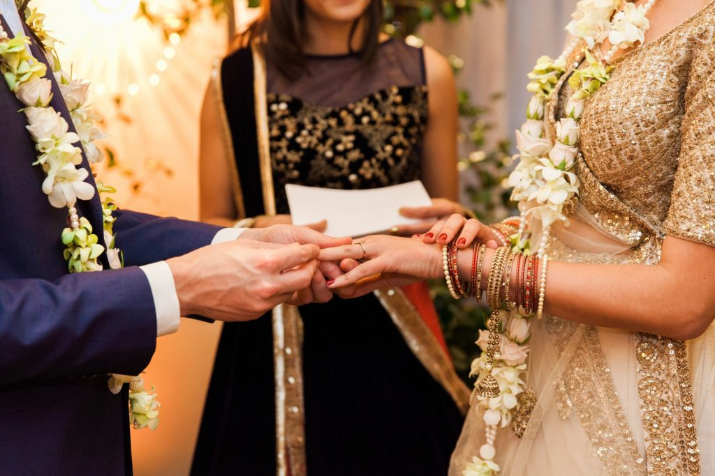 Jewish groom and Indian bride exchange vows during their mixed culture ceremony in London