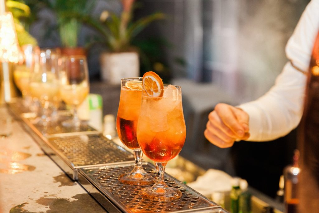 Orange cocktails being made at the Secret Garden bar in South Place Hotel