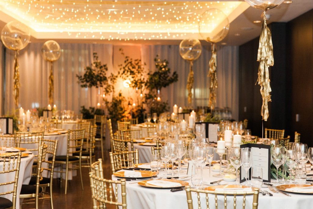 Wedding receptions tables with balloon centrepieces at South Place Hotel