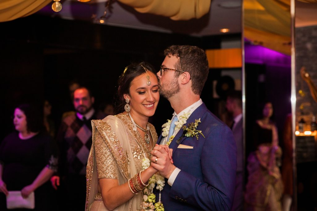 Groom kisses the bride during their first dance at South Place Hotel in London