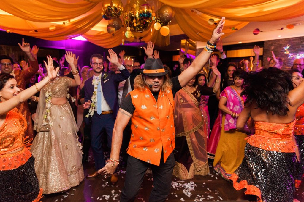 Dancers from Dance With Jay Kumar teaching guests to dance at a South Place Hotel wedding