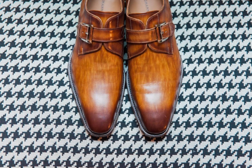 Detail image of the grooms shoes on the morning of his wedding