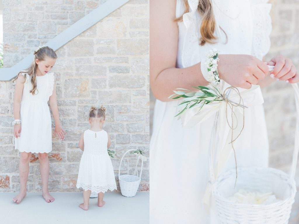 Flower girls collecting their confetti baskets before the elopement begins