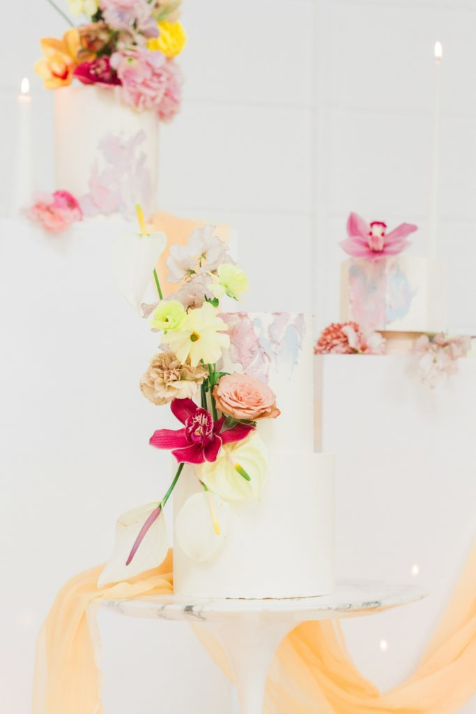 Wedding cakes by Avant Garde Cake Studio with dramatic spring flower toppers