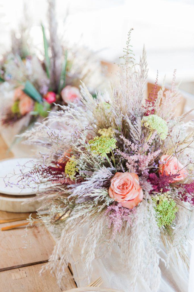 Boho pastel and pampas grass wedding flowers