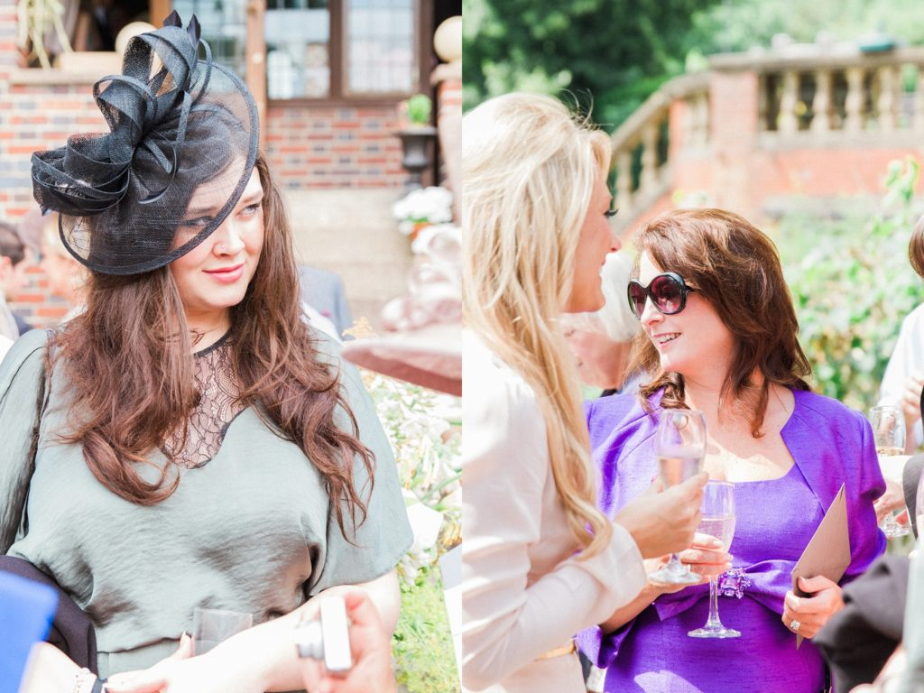 Wedding guests enjoy cocktail hour in the garden of a private residence