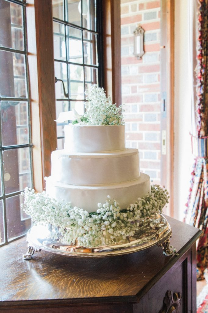 White wedding cake with gypsophila topper