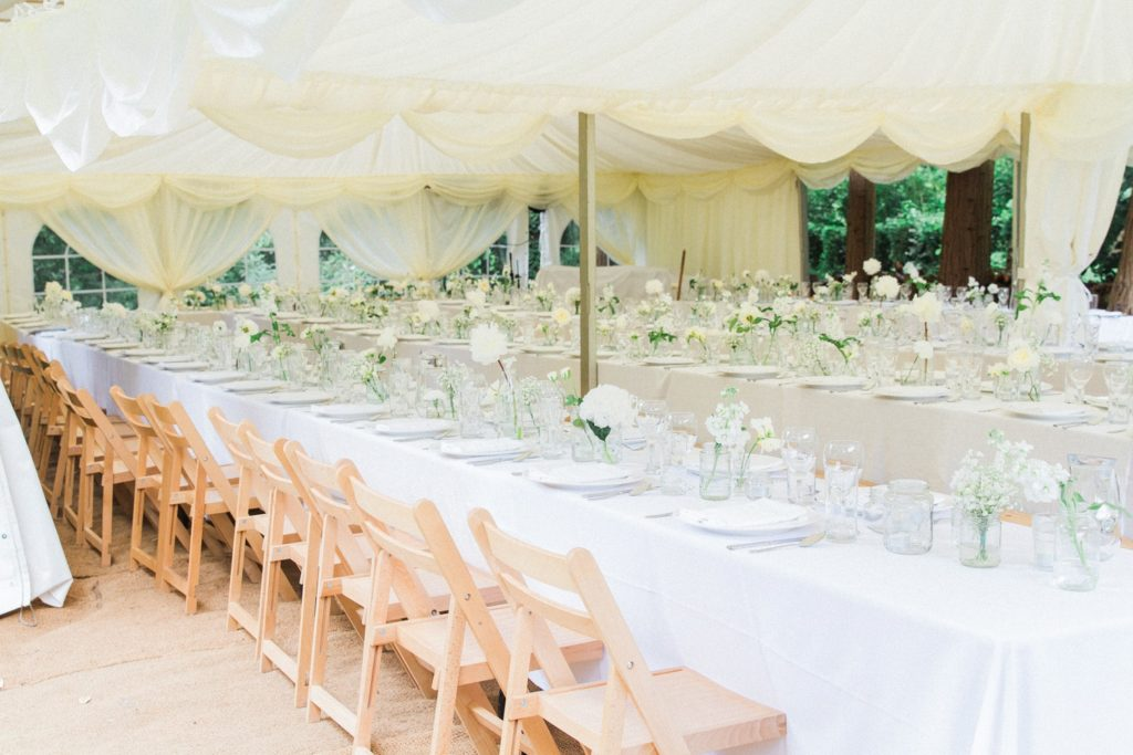Marquee wedding set-up in the garden of a private residence in the English countryside