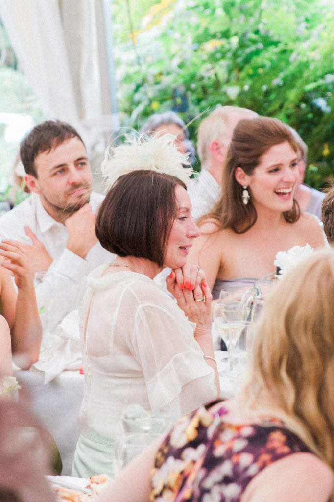 Elegant wedding guest during the speeches