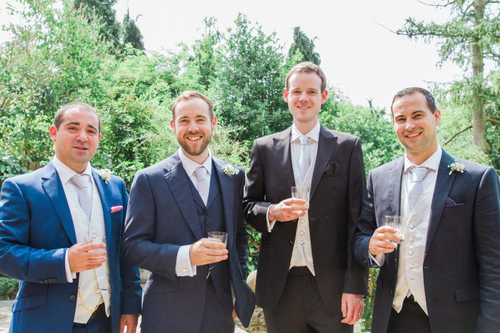 Groom poses with his groomsmen on the morning of his wedding